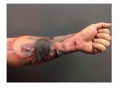 Cool tattoo of Jesus nailed to the Cross.