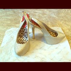 Only worn once. True to size. Compliments any outfit. These heels are a must- have! Glitter gives these heels the right spark! Frederick's of Hollywood Shoes Heels