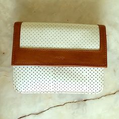 Vintage MUNDI Clutch Handbag Wallet White Brown This cute little bag is in perfect condition and fits an iPhone 6S. One non zipper outside pocket and 4 inside non zipper pockets. One snap detachable coin purse and a zipper inside pocket so 7 pockets total. Also comes with a brown detachable strap (this strap is a little weathered but that is the only fault for this amazing little number)! Mundi Bags Clutches & Wristlets
