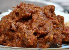 Beef Rendang has a unique flavour, and by varying the amounts of sugar and chilies a whole range of effects can be produced. Serve Beef Rendang over. Spicy Recipes, Slow Cooker Recipes, Indian Food Recipes, Asian Recipes, Beef Recipes, Cooking Recipes, Think Food, Love Food, Food For Thought