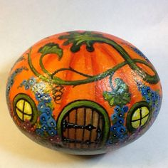 A perfect little pumpkin dwelling for fairies or gnomes. This hand painted beach rock is a sandy stone, so although coated with a protective clear acrylic, it will not stand up to long term weather exposure as well as some other painted rocks.  it measures about 3 tall. 4 wide, and 3 deep
