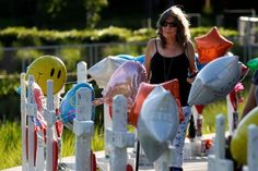 A woman walks past a row of 49 wood crosses commemorating the victims of the Pulse night club shooting in Orlando, Florida, U.S., June 17, 2016.  REUTERS/Carlo Allegri