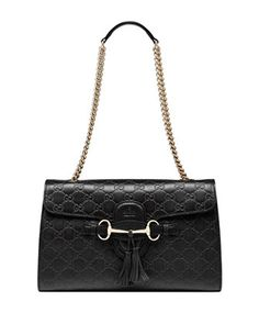 Love the color way, chain, horse bit and size.  Great choice for a black bag with a little extra sum thin' ;)