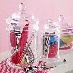 Glass Organizers  Decorative glass containers are ideal holdalls for small items in the bathroom, office, or kitchen. They're the perfect size to store small scoops, tea bags, and muffin cups.