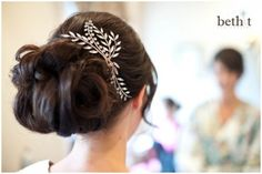 Large mid bridal bun with extensions and curled. Hanging tendrils in front with side swept bangs and med. volume at crown.  CREDIT: Jewel Hair Design: Julie Flury www.jewehd.com  PHOTOG: Beth T