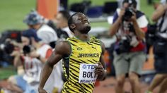 Jamaica's Usain Bolt celebrates after anchoring the team to the gold medal in the men's 4x100m relay at the World Athletics Championships at the Bird's Nest stadium in Beijing, Saturday, Aug. 29, 2015. (AP Photo/Darron Cummings)