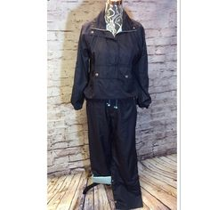 OLEG CASSINI FABULOUS WIND SUIT IN NAVY Awesome wind suit with a pullover 1/2 zip jacket and convertible pants. Like new condition and sooo comfy Oleg Cassini Pants Track Pants & Joggers