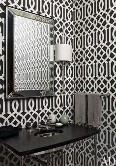 Black and white wallpaper add extra dimension to this bathroom (Architectural Digest)