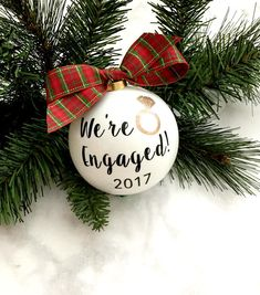 Our Were Engaged Christmas Ornaments are the perfect gift for any engaged couple. Its a great engagement present, bridal shower gift or even Christmas ornament shower! These glass ornaments measure 3 1/2 inches. The ornament will come with the same plaid bow or something comparable. Also, check out the rest of our Christmas ornaments here... https://www.etsy.com/shop/PineappleProper?ref=hdr_shop_menu&section_id=17934952 Thanks for looking! Follow us on Twitter and Instagram @PineappleProper