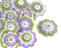 Felt flower embellishments add a special touch to your craft projects from hair accessories to decorating photo frames, purses, pillows and much more.   {D E T A I L S } * You will receive 3 x GRACE felt flowers. You may not receive the exact ones as shown but they will still be just as cute :) * Each one is made using 4 layers of felt with a cute button sewn on top * I use a mix of felt - acrylic, wool mix etc * The measure approx 1.5 each * The individual layers measure 1.5, 1.25, 1 and…