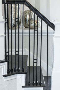 This staircase uses high quality wrought iron balusters to create a unique craftsman style design. Featured is the double bar square baluster (16.6.1) and the plain square bar (16.2.1). These balusters are stocked in hollow or solid wrought iron, and are available in a Satin Black or Ash Grey powder-coated finish. These balusters are paired with industry standard wood components. We supply a variety of stock parts, custom material, and exotic wood. Click the image for more information…