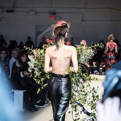 """The designer @AdamSelman called the final look of his fall/winter 2017 collection the """"real fashion moment."""" A topless model walked the runway wearing iridescent silver pants a floral headpiece made in collaboration with the milliner @GigiBurris and a massive bouquet of flowers designed by @saipua while a soundtrack of western music played in the background. Photo by Eli Schmidt (@elischmidtphoto).  via NY TIMES STYLE MAGAZINE OFFICIAL INSTAGRAM - Celebrity  Fashion  Haute Couture…"""