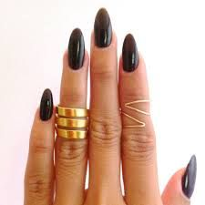 stiletto nails and stunning rings. LOVE IT !!!