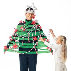 Don't limit your tree-trimming traditions to your evergreen. Transform Dad into a decorated Christmas tree.  Supply your kids with green and red crepe paper, aluminum foil, and masking tape. When they're done, gather 'round the tree and take a photo to add to your family album or send as next year's holiday card.
