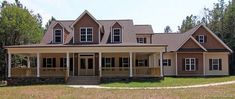 Low Country Farmhouse by Max Fulbright is a Farmhouse Style House Plan with a wraparound porch, open floor plan and a Master Suite on the main level.