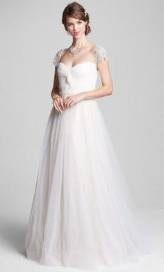 Reem Acra Roses: buy this dress for a fraction of the salon price on PreOwnedWeddingDresses.com