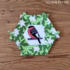 Bullfinch and wood anemone hexie patchwork block. Original fabrics from Sea Parrot available on Folksy or directly from me. Wood Anemone, Bullfinch, Patchwork Fabric, Plant Art, Parrot, Woodland, Fabrics, Arts And Crafts, Birds