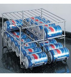 The Chrome Wire 24-Can Beverage Dispenser is a great alternative to retrieving cans from the cardboard box. This beverage can organizer features a two-tier design that holds up to 24 standard 12 ounce cans rolls cans down and easily dispenses a can at a time stops the prevent cans from rolling out the front and a wire