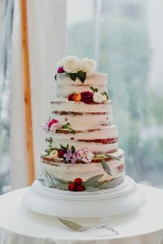 nearly naked flower topped wedding cake