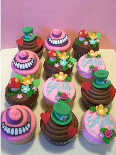 Alice in Wonderland cupcakes. [: I like the ones that say Eat Me and the ones with the mushrooms and flowers. I'm not crazy about the Mad Hatter and Cheshire Cat one's though. Alice In Wonderland Cupcakes, Alice In Wonderland Tea Party, Mad Hatter Party, Mad Hatter Tea, Mad Hatters, Alice Tea Party, Tea Party Birthday, Birthday Ideas, Birthday Cakes