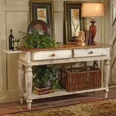 """2-drawer hardwood sideboard in antiqued white with an open bottom shelf, pull-out tray, and twist legs.         Product: Sideboard   Construction Material: New Zealand pine wood     Color: Antique white   Features: English dovetail joints  Two drawers and one shelf  Hand-rubbed finish        Dimensions: 35"""" H x 60"""" W x 18"""" D"""