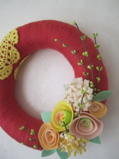 Rouge Yarn Wreath with Doily 12 by polkadotafternoon on Etsy. Materials: felt, yarn, doily, straw wreath