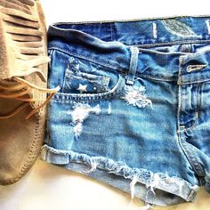 ✨Vamped up Hollister Jean shorts✨ These are Hollister jeans vamped up distressed! Added stars fabric handkerchief in back pocket! Patched front pocket! Added blue patch with white stars under distressed left leg! Hand drawn bleached feather☺️ recommend spot cleaning or hand wash gentlysize 3. Make an offer✌️No trades thank you Hollister Shorts Jean Shorts