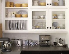 Glass Kitchen Cabinet Doors on Glass Front Cabinets With Black Door Knobs And Open Plate Rack Glass Kitchen Cabinet Doors, Glass Front Cabinets, Best Kitchen Cabinets, Kitchen Shelves, Kitchen Tiles, Kitchen Flooring, New Kitchen, Cupboards, Glass Doors