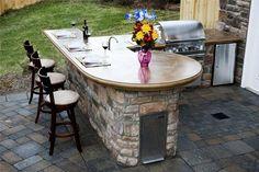 Beautiful mixture of concrete and natural stone in this outdoor kitchen design. Mid Atlantic Enterprise Inc Williamsburg, VA