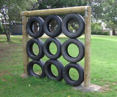 Hmmm, fitness equipment or vertical garden?  This would be a beautiful privacy wall with flowers pouring out of each tire.