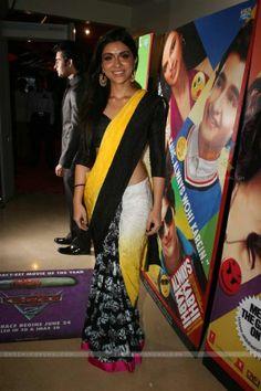 celebs in black, white & yellow saree.