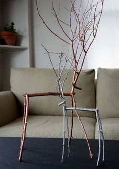 Make some festive reindeer crafts to dress up your mantle or bookshelf for Christmas. They're easy to make, and cost next to nothing. http://hative.com/diy-ideas-with-twigs-or-tree-branches/