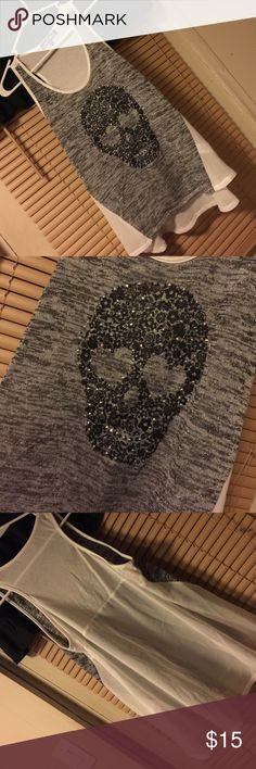 Skull Tank Top Grey and White Skull Tank Top. Fits small for an XL maybe recommend for those who fit in L. Almost Famous Tops Tank Tops