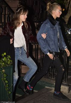 Who needs St Vincent: Cara was walking arm-in-arm with the 50 Shades Of Grey starlet Dakota Johnson