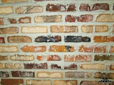 An interior red brick wall in different shades. Red Brick Walls, Brick Tiles, Interior Walls, Interior Design, Thin Brick, Manufactured Stone, Stone Panels, Fireplace Remodel