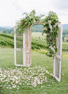 whimsical outdoor wedding ceremony door backdrop - brides of adelaide