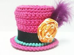 mini crochet top hat.. I have been making these so simple and quick to do up. Great for kids parties.