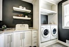 sink and washer/dryer set up higher with hanging rail