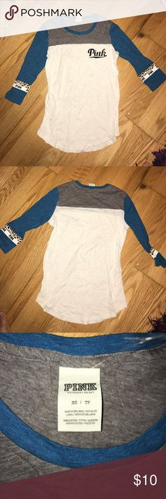 victoria secret PINK quarter sleeve shirt A white gray and blue Victoria's Secret pink shirt with cheetah print stripes on the arms PINK Victoria's Secret Tops Tees - Long Sleeve