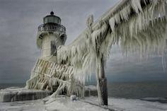 Frozen Lighthouse in Lake Michigan Photography by Tom Zakowski