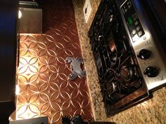 Faux copper backsplash.