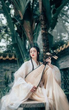 Beautiful Chinese girl in Hanfu and her Pipa
