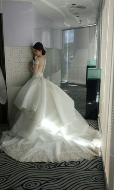 Custom made Jo Rubio bridal gown embellished with origami overskirt and beaded embroidery
