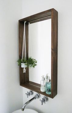 Add personality—and storage—to a small bath using this guide for how to frame a bathroom mirror. The ledge on this DIY framed mirror is a game-changer. diy bathroom How to Frame a Bathroom Mirror—with a Ledge Bathroom Mirrors Diy, Diy Bathroom Decor, Bathroom Storage, Bathroom Makeovers, Bathroom Small, Bathroom Mirror Makeover, Bathroom Ideas, Diy Mirror Decor, Bathroom Remodeling