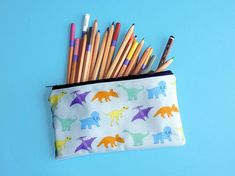 Items similar to Dinosaur pencil case - child's pencil pouch - dinosaur lover gift - colourful zip pouch - unique dinosaur print fabric - animal makeup bag on Etsy Pencil Pouch, Pencil Cases, Dinosaur Gifts, Gift For Lover, Printing On Fabric, How To Draw Hands, Coin Purse, Stationery, Pouches