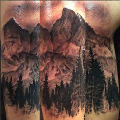 Grand Teton Mountain Range in Jackson Hole Wyoming. Done by Shykeim Rashidah from Art-I-Facts Tattoo Gallery in Huntsville, AL.