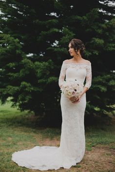Gorgeous off the shoulder lace wedding dress with 3/4 sleeves.