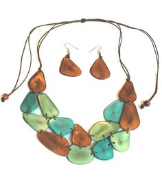 The Journey tagua nut necklace on brown, green and turquoise