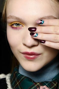 The Best Beauty Inspiration From Milan Fashion Week Fall 2016: Bright Eye Makeup and Nail Art at the I'M Isola Marras Show // See All of the Coolest Beauty Moments from MFW: (http://www.racked.com/2016/3/1/11135602/milan-fashion-week-beauty)