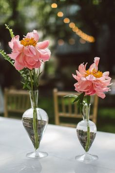 Peony in pendulum vases | Truman Show Perfection In This Photo Perfect Seaside Florida Wedding | Photograph by Hello Miss Lovely  http://storyboardwedding.com/truman-show-perfection-photo-perfect-seaside-florida-wedding/